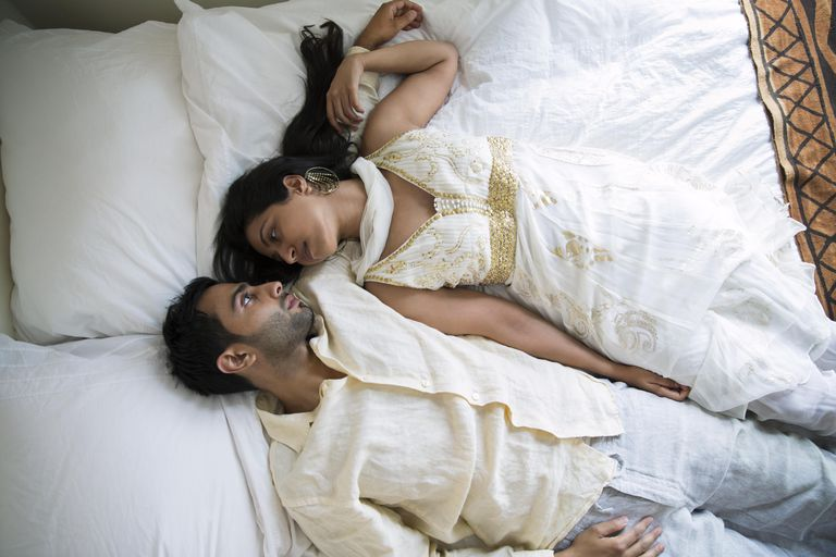 Indijanac Couple Laying Together on a Bed
