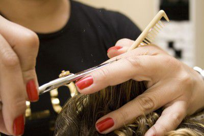 A picture of a hair stylist cutting hair