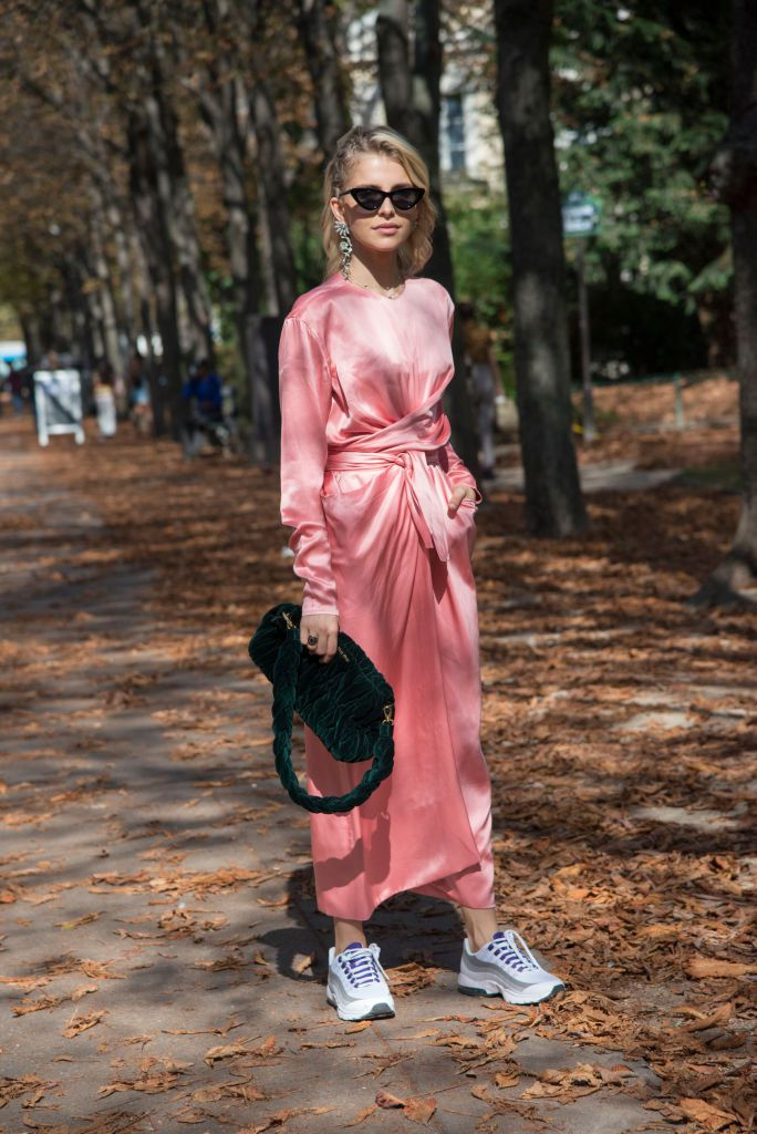 Ulica style woman wearing a fancy summer maxi dress with sneakers