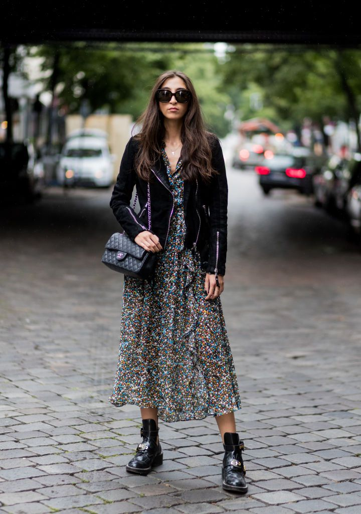 Ženska wearing biker jacket and maxi dress for street style