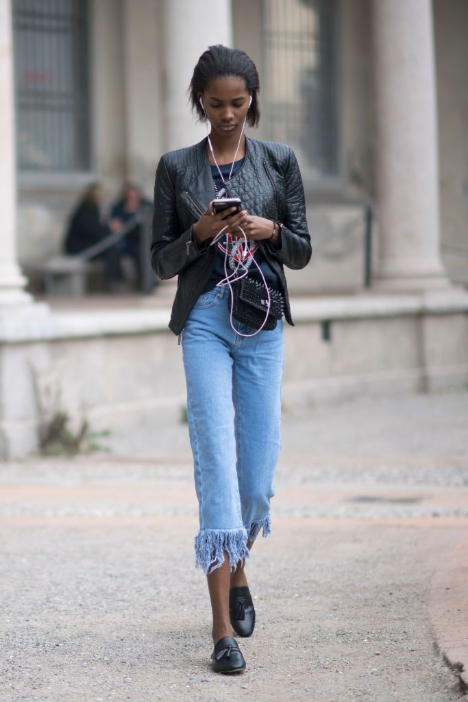 Ulica style in fringed hem jeans and a leather jacket